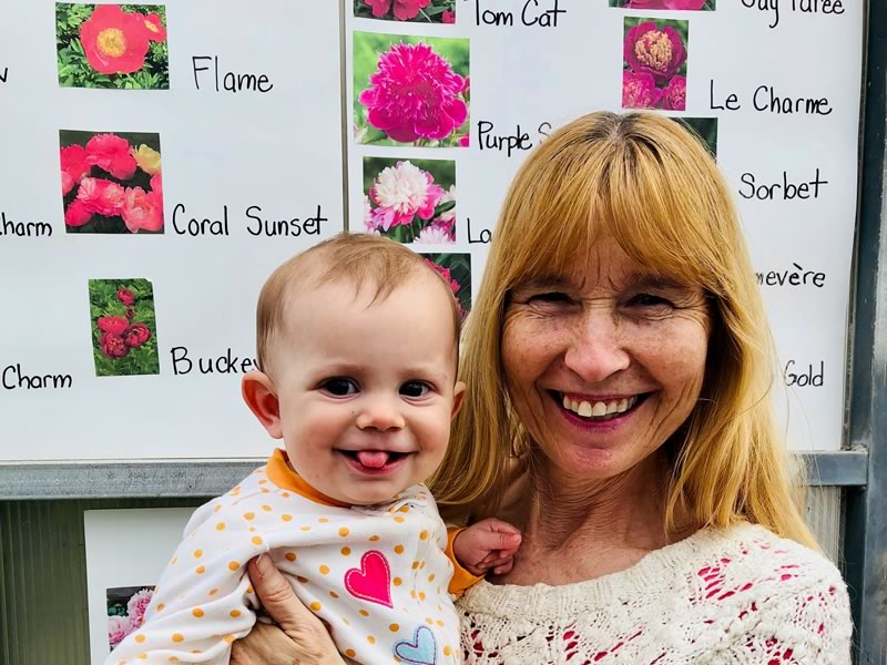 Inge and baby Primrose enjoying the Peonies